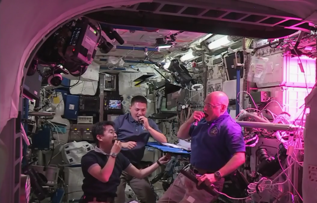 The first time space-grown food has been eaten. From left to right you can see Kimiya Yui, Kjell Lindgren and Scott Kelly (Image credit: NASA TV).