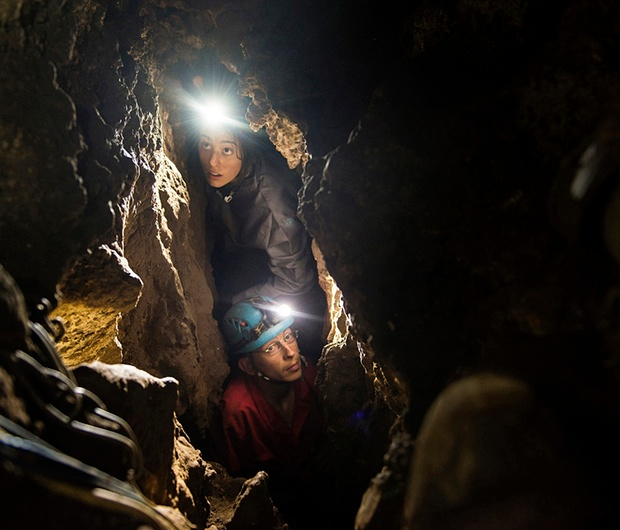 Megan Berger and Rick Hunter navigate the narrow passages leading to the hominin remains. (Image credit: Robert Clark/National Geographic).