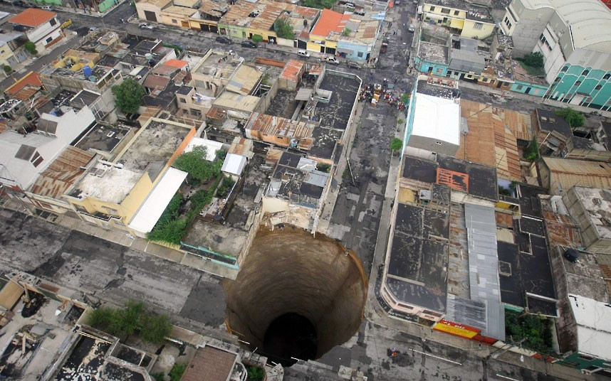 This sinkhole is 20 metres wide and 30 metres deep. It opened up in Guatamala in 2010, swallowing a 3-storey building. (Image credit: Guatemala's Presidency, Luis Echeverria/AP).