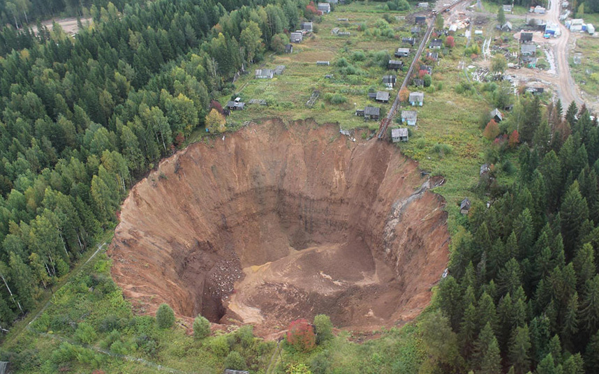 This sinkhole in the Perm region of Russia appeared when a potash mine collapsed in 2014. It's currently 125 metres across and 75 metres deep, and is increasing in size. (Image credit: Uralkali Press Service/Odnoklassniki).